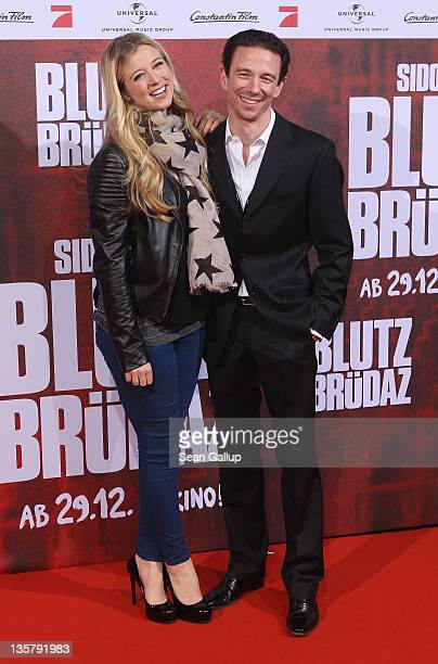 Nina Eichinger and Oliver Berben attend the 'Blutzbruedaz' premiere at CineStar Sony Center on December 14 2011 in Berlin Germany