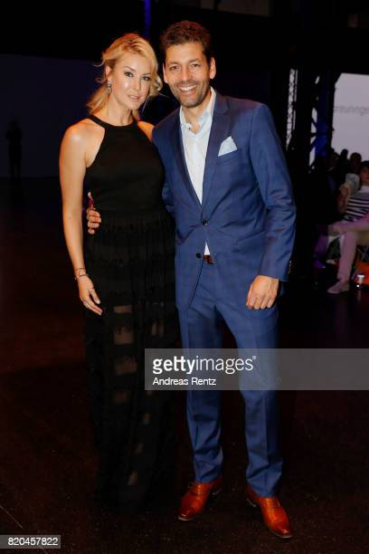 Nina Ensmann and Marc Demmig attend the Breuninger show during Platform Fashion July 2017 at Areal Boehler on July 21 2017 in Duesseldorf Germany