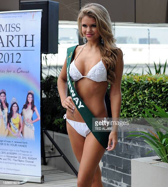 Nina Fjalestad of Norway poses for photographers during a press presentation of the Miss Earth beauty pageant at a hotel in Manila on November 6 2012...
