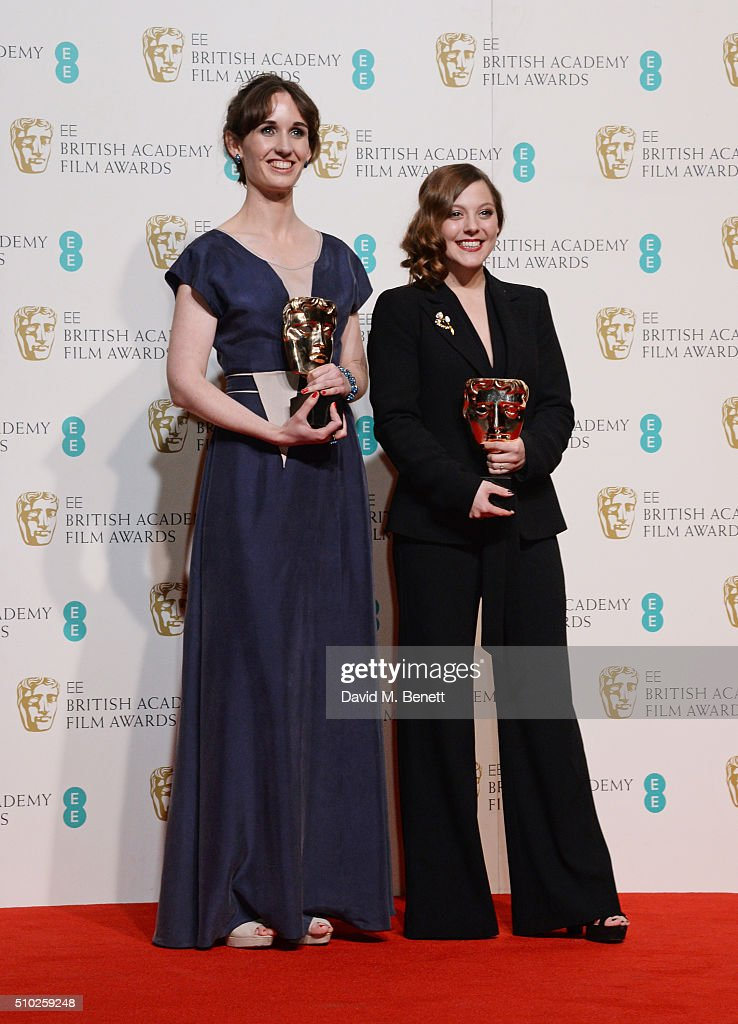 Nina Gantz (L) and Emilie Jouffroy, winners of the British Short Animation award for 'Edmond', pose in the winners room at the EE British Academy Film Awards at The Royal Opera House on February 14, 2016 in London, England.