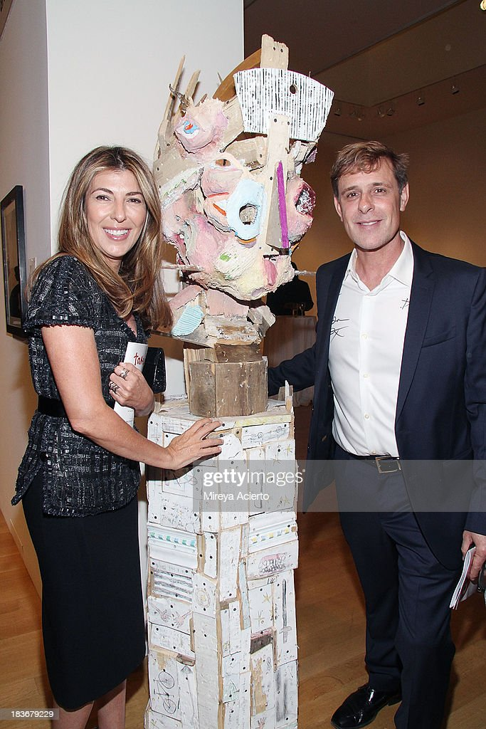 <a gi-track='captionPersonalityLinkClicked' href=/galleries/search?phrase=Nina+Garcia&family=editorial&specificpeople=592222 ng-click='$event.stopPropagation()'>Nina Garcia</a> and David Colbert attend the 2013 'Take Home A Nude' Benefit Art Auction And Party at Sotheby's on October 8, 2013 in New York City.