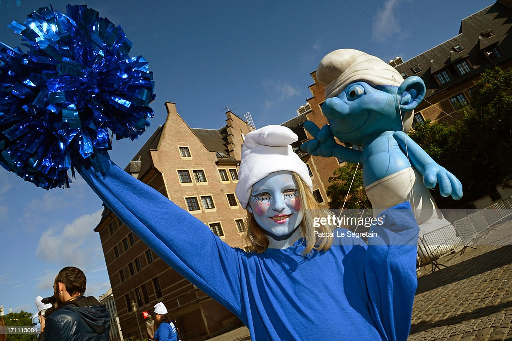 Nina Guerin Culliford, the granddaughter of cartoonist Peyo, the creator of The Smurfs, poses by a giant Smurf character during Global Smurfs Day celebrations on June 22, 2013 in Brussels, Belgium.