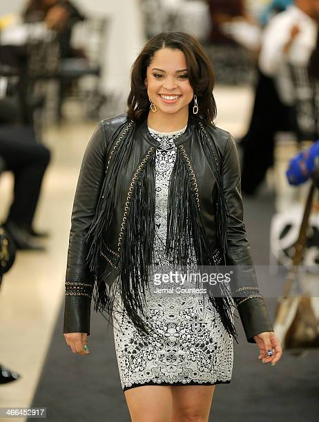 Nina Heisser walks the runway at the Saks Fifth Avenue And Off The Field Players' Wives Association Charitable Fashion Show on January 31 2014 in New...
