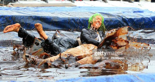 Nina Jarrett and Karen Foster take part in the World Gravy Wrestling Championships at the Rose n Bowl Stackteads in Lancashire