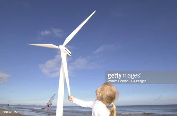 Nina Jones age 3 from Prestatyn north Wales with a model wind turbine on the beach at Rhyl Her family are the first to sign up for Juice an offshore...
