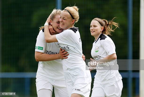 Nina Lange of Guetersloh jubilates with team mates after scoring the second goal during the U17 Girl's Bundesliga semi final first leg match between...
