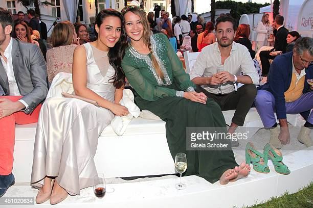 Nina Moghaddam and Laura Osswald attend the Raffaello Summer Day 2014 at Kronprinzenpalais on June 21 2014 in Berlin Germany