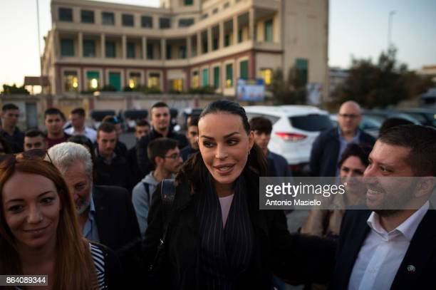 Nina Moric Carlotta Chiaraluce and Luca Marsella speak during a meeting organized by farright political movement Casapound to support Luca Marsella...