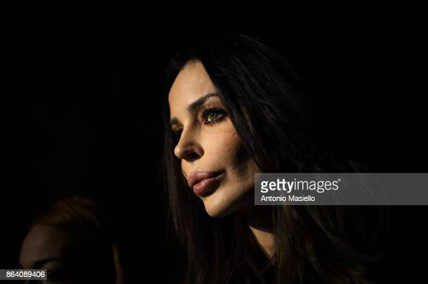 Nina Moric speaks with journalists during a meeting organized by farright political movement Casapound to support Luca Marsella their candidate for...