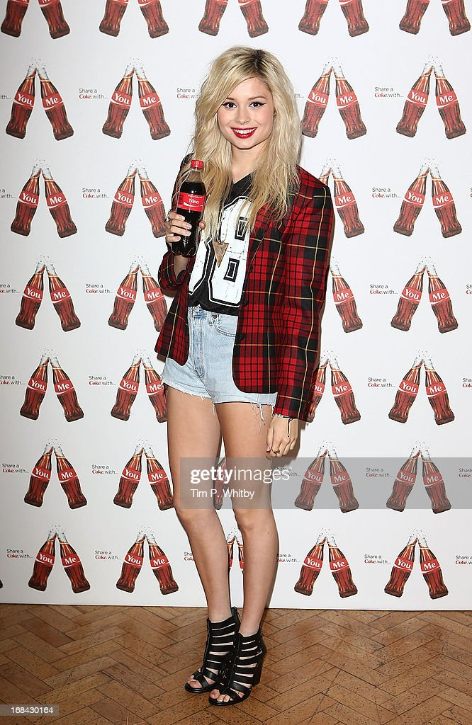 Nina Nesbitt with her personalised Coke bottle at the launch of Coca-Cola's, Share a Coke campaign at One Marylebone on May 9, 2013 in London, England.