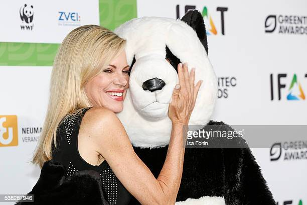 Nina Ruge with the Green Tec mascot attends the Green Tec Award at ICM Munich on May 29 2016 in Munich Germany