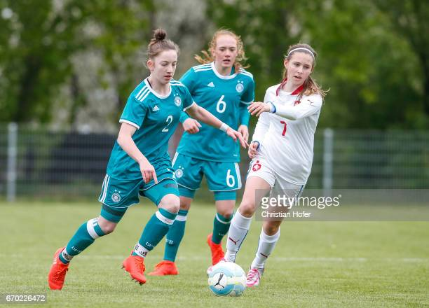 Nina Schumacher and Lisanne Grawe of Germany challenge Katerina Furikova of Czech Republic for the ball during the Under 15 girls international...
