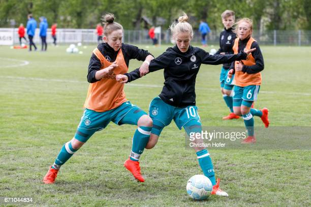 Nina Schumacher and Sophie Krall of Germany in action during the warm up session prior to the Under 15 girls international friendly match between...