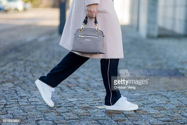 Nina Schwichtenberg wearing a nude Marc Cain wool coat grey Marc Cain bag navy Marc Cain jogger pants white turtleneck white sneaker during the...