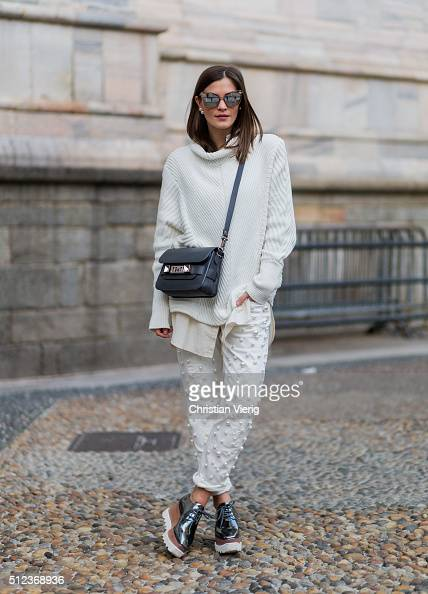 Nina Schwichtenberg wearing Escada pants Proenza Shouler bag Stella McCartney shoes seen outside during Milan Fashion Week Fall/Winter 2016/17 on...
