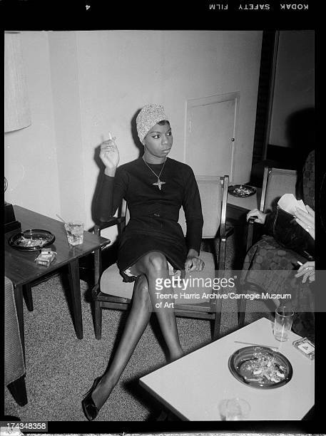 Nina Simone holding cigarette and seated in chair Pittsburgh Pennsylvania c 1965