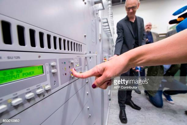Nina Stensrud Martin and Olav Viksmo Slettan turn off the FMband in Tryvannstarnet near Oslo on September 20 as Norway is closing down its analog...