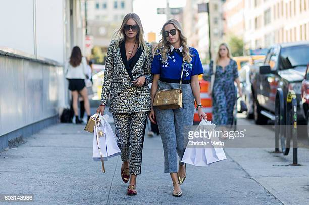 Nina Suess and Camila Carril wiht shopping bags outside J Crew on September 11 2016 in New York City