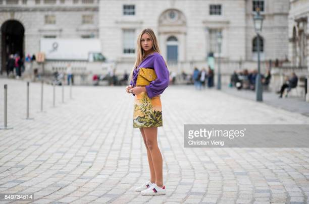 Nina Suess wearing purple Marc Cain blouse a Marc Cain skirt with a tiger jungle print yellow Marc Cain bag during London Fashion Week September 2017...