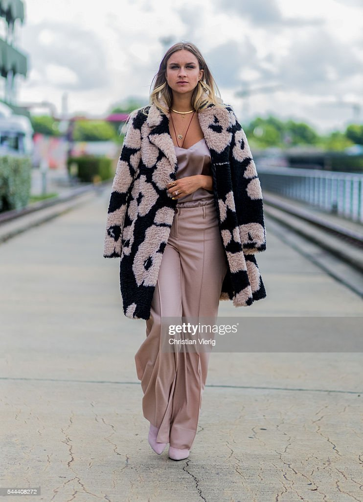 Nina Suuess wearing a Marc Cain coat pants and shirt during the MercedesBenz Fashion Week Berlin Spring/Summer 2017 on June 28 2016 in Berlin Germany