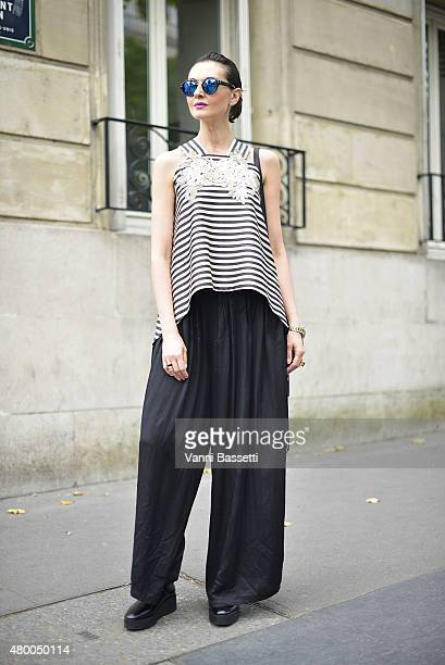 Nina Tskitishvili poses wearing a Tamara Ingorokva dress before the Zuhair Murad show at the Palais de Tokyo on July 9 2015 in Paris France