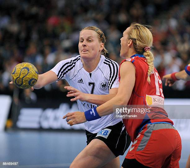 Nina Woerz of Germany is challenged by Jelena Eric of Serbia during the Women's Handball World Championship qualification game between Germany and...