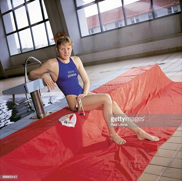Nina Zhivanevskaia swimmer Nina Zhivanevskaia sitting next to a swimming pool
