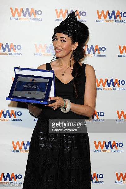 ACCESS *** Nina Zilli attends the Wind Music Awards Backstage at the Arena of Verona on May 29 2010 in Verona Italy