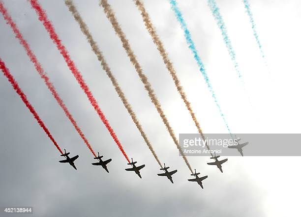 Nine Alpha Jets of the French Air Force La Patrouille de France releasing trails of blue white and red smoke the colors of the French national flag...
