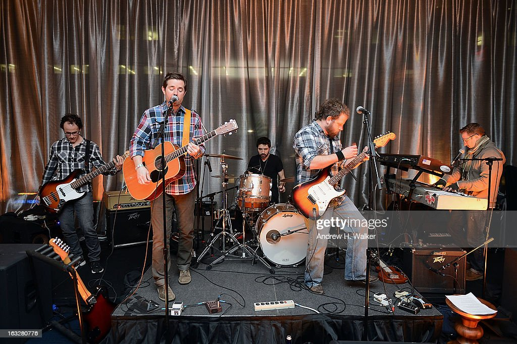 Nine Days band members Nick Dimichino, John Hampson, Vincent Tattanelli, Brian Desveaux and Jeremy Dean perform at the City Harvest: A Mid-Winter Escape on March 5, 2013 in New York City.