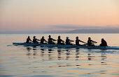 Nine people rowing