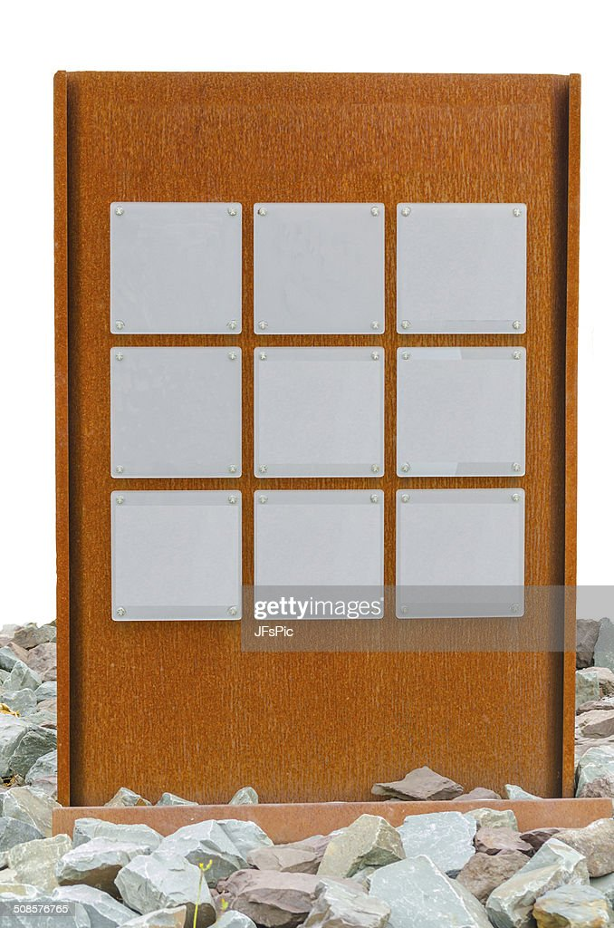 Nine plates on metal wall : Stock Photo