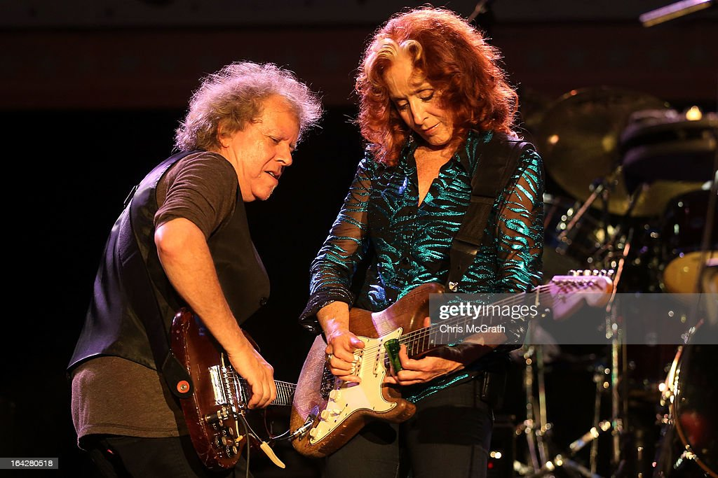 Nine time Grammy Award winner Bonnie Raitt (R) performs on stage during the Timbre Rock & Roots Festival 2013 on March 22, 2013 in Singapore.