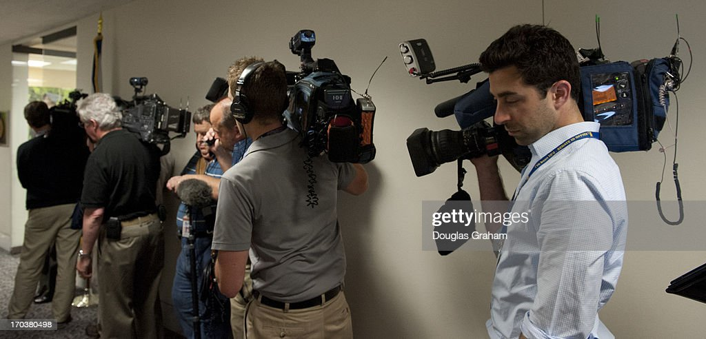 Nine TV crews clog the hallway outside Sen. Joe Manchin, D-WVA., office as they wait to cover a press conference with the Newtown families of the Sandy Hook shooting victims in the Hart Senate Office Building on June 12, 2013.