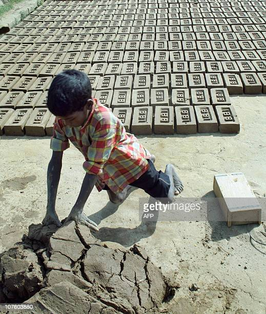 Nine year old child labourer Sanjoy Munda makes brick in a brick field in Barjala 14 kilometer east of Agartala capital of the northeastern state of...