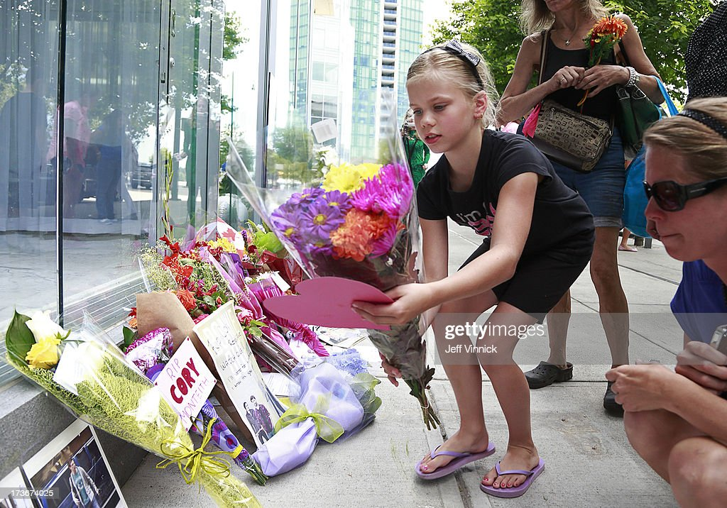 Nine year-old Ava Studiman places flowers and a heart on a memorial to deceased actor Cory Monteith outside the Fairmont Pacific Rim Hotel on July 16, 2013 in Vancouver, British Columbia, Canada. The B.C. Coroners Service released results of Monteith's autopsy today and found the 31-year-old's cause of death was a mixed drug toxicity involving heroin and alcohol.