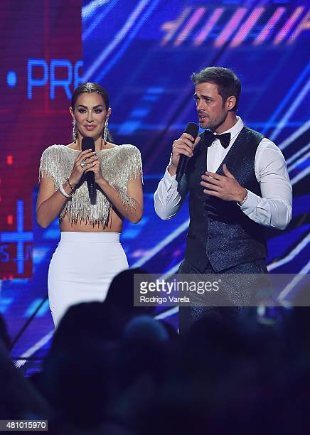Ninel Conde and William Levy speak onstage at Univision's Premios Juventud 2015 at Bank United Center on July 16 2015 in Miami Florida