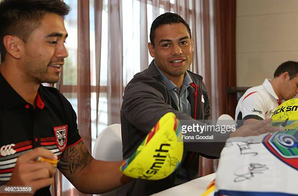 Nines captains Shaun Johnson Warriors and Ben Te'o South Sydney Rabbitohs sign merchandise during the Auckland Nines captain's and coach breakfast at...