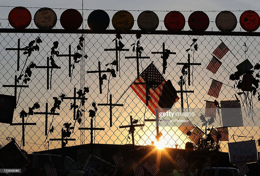 Nineteen crosses and American flags adorn the fence outside of Station 7 on July 3, 2013 in Prescott, Arizona. Nineteen firefighters based out of Station 7 died battling a fast-moving wildfire near Yarnell, Arizona on June 30. Station 7 has been the home of the Granite Mountain Interagency Hotshot Crew since 2010.