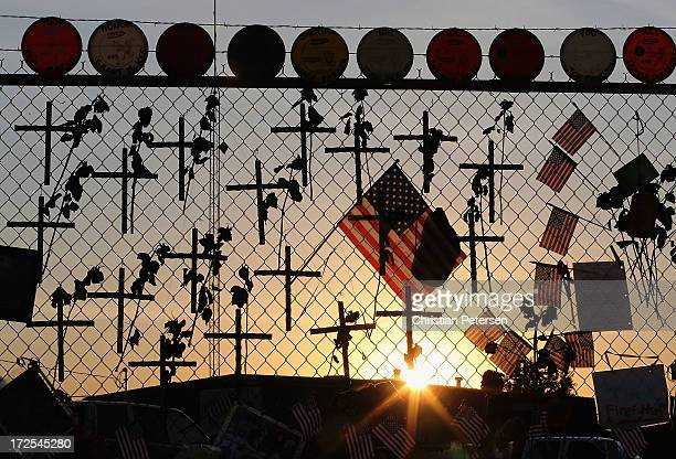Nineteen crosses and American flags adorn the fence outside of Station 7 on July 3 2013 in Prescott Arizona Nineteen firefighters based out of...