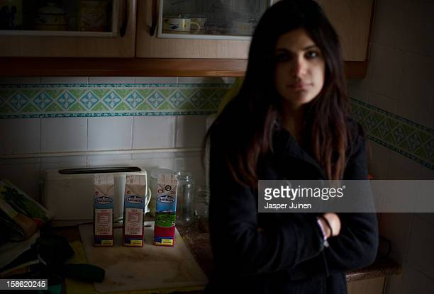 Nineteen year old Maria Gonzales stands in the kitchen of her home where she lives with her fifteen year old sister Jennifer and their fiftyyear old...