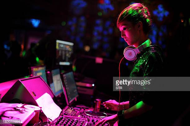 Nineteenyearold Chinese DJ Li Chengxue works at a club in Hefei east China's Anhui province on November 8 2011 As the many million of graduates and...