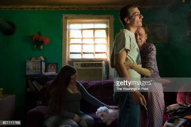 Nineteenyearold Tyler McGloghlin hugs his mother Sheila who is stressed out over money and her failing health in Grundy VA on May 26 2017 Sheila...