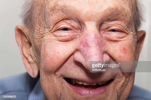 Ninety year old senior man laughing close up