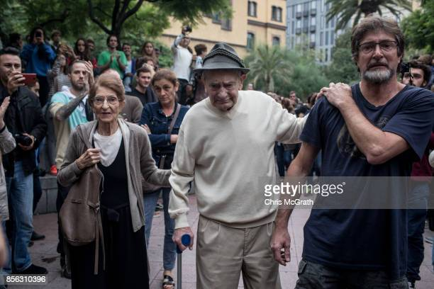 A ninetyyear old man is cheered and clapped by the crowd as he leaves after casting his referendum vote at the Escola Industrial of Barcelona school...