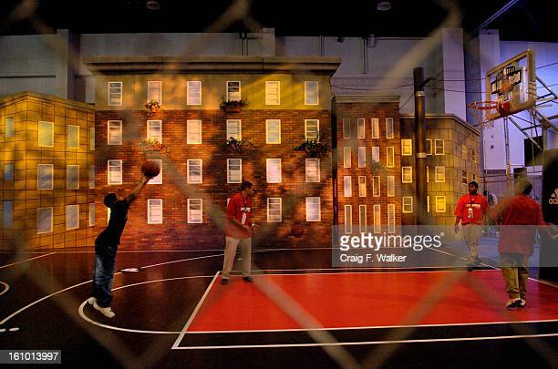 FEBRUARY 18 2005 DENVER CO Nineyearold Camron Wright of Aurora CO tries his hand at shooting while taking part in the Adidas Shoot Around He and his...