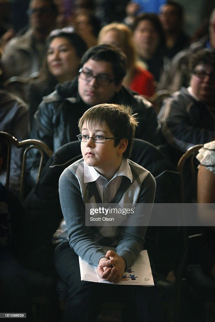 Nine-year-old Christian Bugaian, who is from Moldova, participates in a citizenship ceremony at the Chicago Cultural Center on February 12, 2013 in Chicago, Illinois. The ceremony was held to recognize as new U.S. citizens 62 children, ages 6-18, from 23 countries who were adopted from abroad or who derived U.S. citizenship when their immigrant parents were naturalized.
