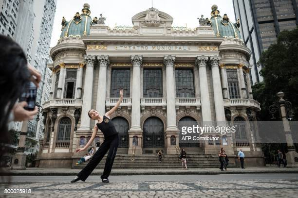 Nineyearold Gabriela Marcal Leitao a ballet student at the Theatro Municipal poses for her mother in front of the Theatro Municipal in Rio de Janeiro...