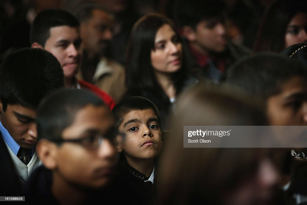 Nine-year-old Mukal Verma (C) from India participates in a citizenship ceremony at the Chicago Cultural Center on February 12, 2013 in Chicago, Illinois. The ceremony was held to recognize as new U.S. citizens 62 children, ages 6-18, from 23 countries who were adopted from abroad or who derived U.S. citizenship when their immigrant parents were naturalized.