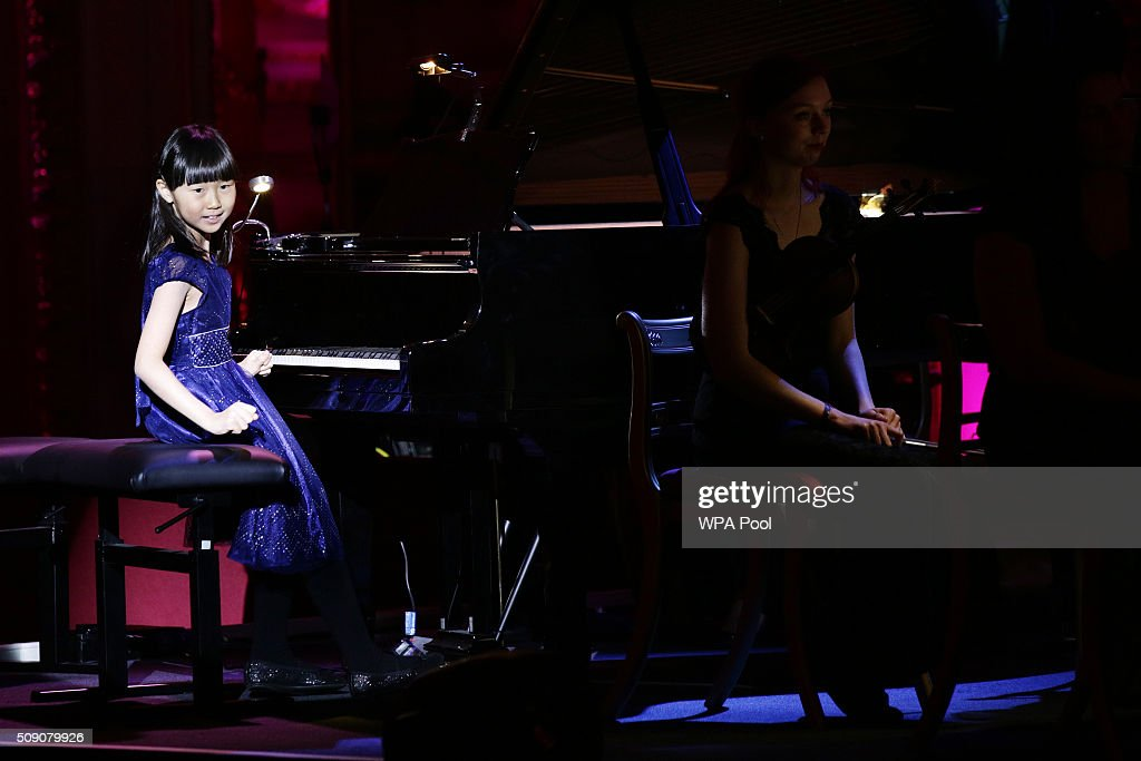 Nine-year-old pianist Charlotte Kwok, from Llanharan, who is a member of the Royal Welsh College of Music and Drama's junior conservatoire, performat a gala concert for the Royal Welsh College of Music and Drama at Buckingham Palace on February 8, 2016, in London England.